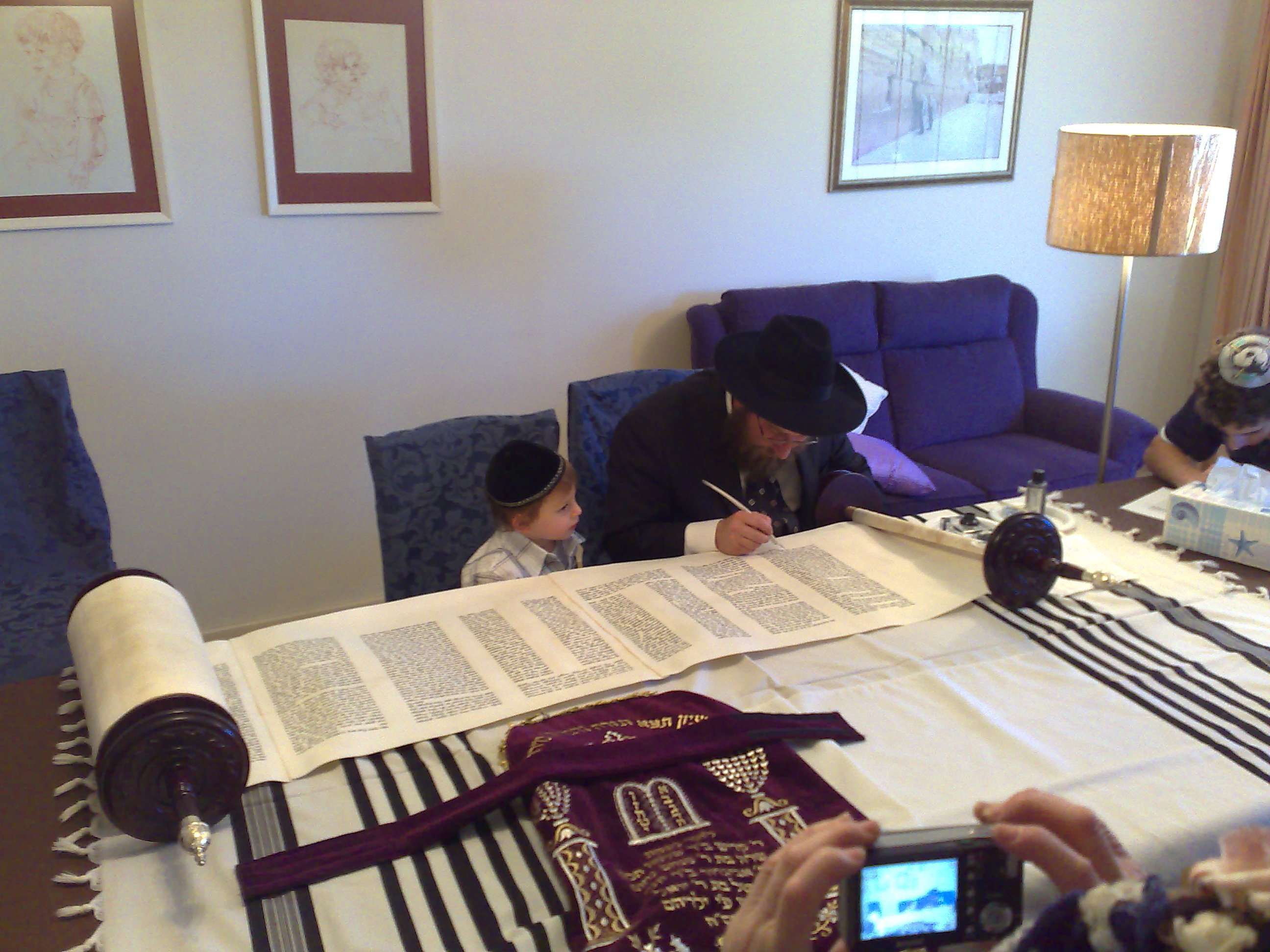 The Torah being completed